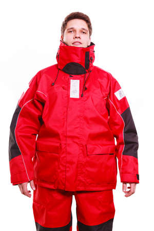 protective clothing: Man wearing protective clothing. Young male in red oilskin. Adventure danger waterproof action outdoor concept.