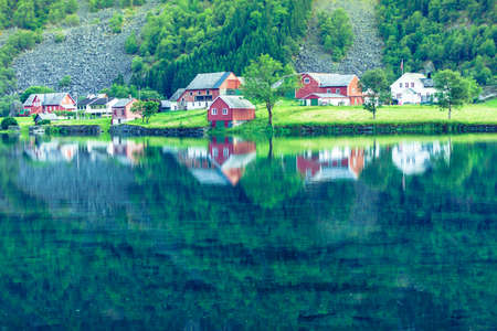 Norwegian country house hytte in the mountains. Beautiful coastline fjords landscape in Norway, Scandinavia Europe Imagens
