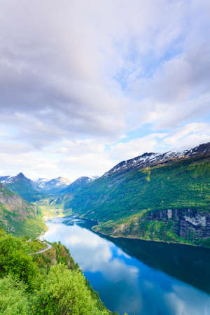 scandinavia: Tourism vacation and travel. Beautiful view over magical Geirangerfjorden from Flydalsjuvet viewpoint, Norway Scandinavia.