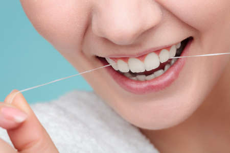 Smiling Women Use Dental Floss Stock Photo Picture And Royalty Free Image 66765499