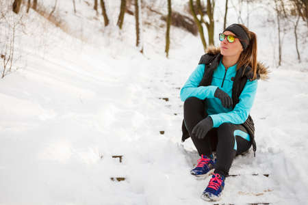 staying fit: Girl dressed up for winter. Staying fit despite cold. Health fitness nature fashion concept.
