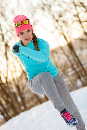 staying fit: Girl staying fit during winter, exercising in winter park. Fitness health fashion concept