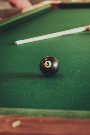 billiard: Billiard balls and cue stick on green table. Pool game Stock Photo