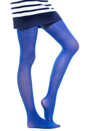 long stockings: Female fashion. Woman long legs and color blue stockings isolated on white background Stock Photo