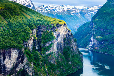Tourism vacation and travel. Beautiful view over magical Geirangerfjorden from Flydalsjuvet viewpoint, Norway Scandinavia. Imagens - 67279117