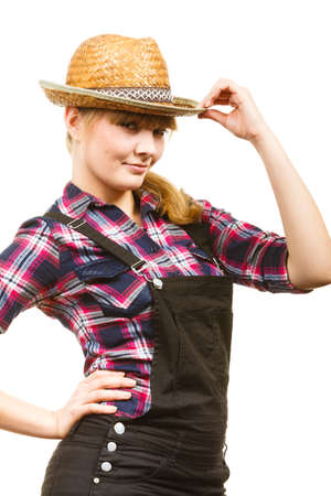dungarees: Gardening concept. Attractive woman in dungarees, pink check shirt and sun hat posing and smiling. Isolated background