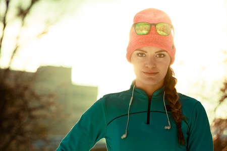 staying fit: Sporty girl showing her beauty. Staying fit and war in winter. Health nature fitness fashion concept. Stock Photo