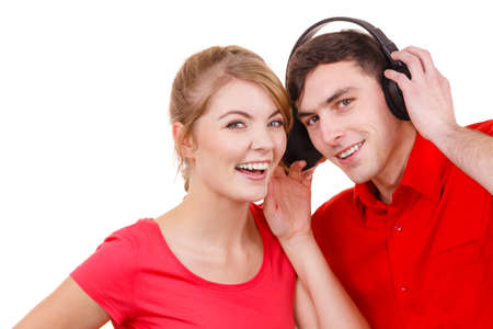 mp3 player: Couple two friends with big headphones listening to music mp3 together. Joyful happy woman and man on white. People leisure happiness concept.