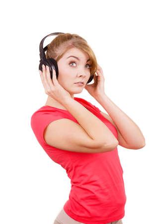 mp3 player: Woman sad unhappy girl in big headphones listening music mp3 closeup on white. Broken heart love concept