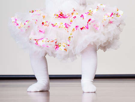 ballerina tights: Lovely little child girl in princess fairy dress and white tights. Part body of baby ballerina.
