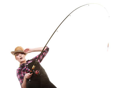 sportfishing: Spinning equipment, angling, cheerful fisherwoman concept. Happy woman in sun hat holding fishing rod, having fun while hunting for fish