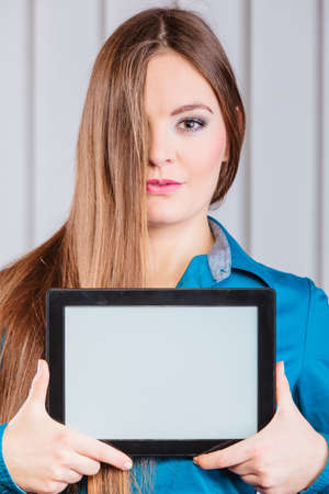 hair cover: Technology help in career business and work advertisement. Young woman hold tablet portable computer show advice and help. Hair cover face. Stock Photo