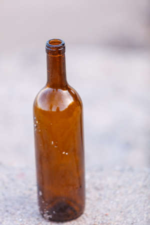 boozer: forgotten wine bottle outdoor. Abuse and alcoholism problems Stock Photo