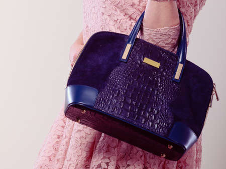 body bag: Shopping time. Part body of trendy woman wearing lovely lace pink dress. Lady with elegant black bag handbag.