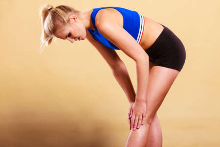 sprained joint: Woman fitness girl with bad injured knee. Sport training gym and health care