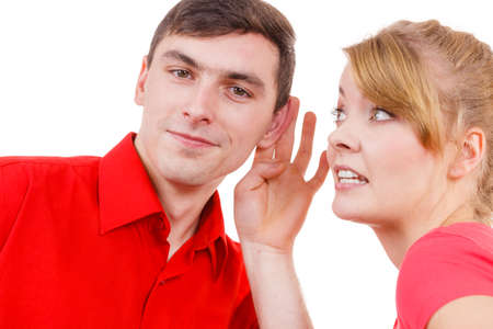 gossiping: Woman telling man some secrets, couple talking gossiping. Excited emotional girl whispering to boyfriend ear