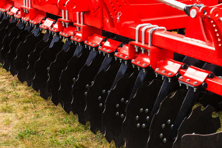 agriculture machinery: Agriculture equipment concept. Detailed closeup of disc harrow, agricultural machinery. Outdoor shot