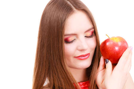 lose up: Woman young charming female long haired colorful make up holds big red apple fruit. Healthy eating, vegetarian food, dieting and people concept.