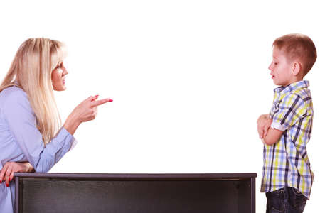 Relationships arguments and discussion. Mother and son sit at table and argue discuss solve problem. Stock Photo