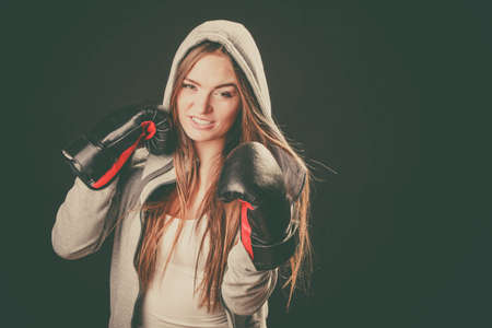 Exercising and fighting with opponent. Sportsmanship and strong body. Energetic woman wear sportswear and boxing gloves. Sport and fitness healthy lifestyle.