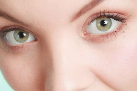 eyes wide open: Woman with eyes wide open. Part of face, closeup. Stock Photo