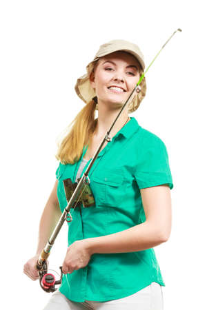 sportfishing: Fishery, spinning equipment, angling sport and activity concept. Happy smiling woman with fishing rod.
