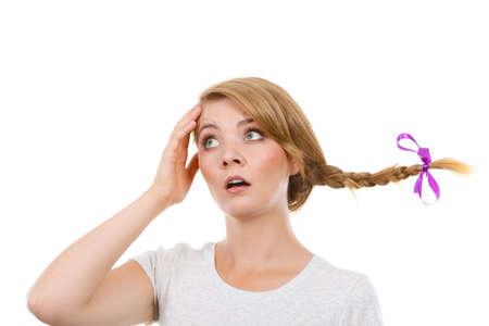 melancholia: Emotions expressions, sadness concept. Teenage girl in blonde braid windblown hair making sad face.