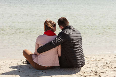 realtionship: Romance, beautiful relantionship concept. Happy couple having date on beach near sea.
