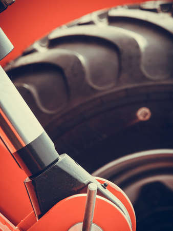 Agriculture equipment concept. Detailed closeup agricultural machinery, big wheels with tires. Outdoor shot Stock Photo