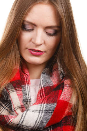 Autumnal outfit concept. Young long haired woman wearing warm autumn clothing woolen checked scarf isolated on white