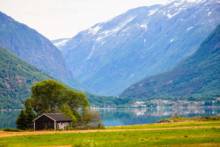 Tourism vacation and travel. Mountains landscape and fjord in Jostedalsbreen National Park, Oppstryn (Stryn), Sogn og Fjordane county. Norway Scandinavia.