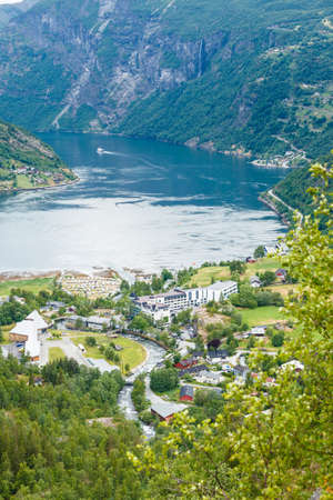 Tourism vacation and traveling. Fantastic view on Geirangerfjord green mountains landscape and village Geiranger, travel destination in Norway Scandinavia.