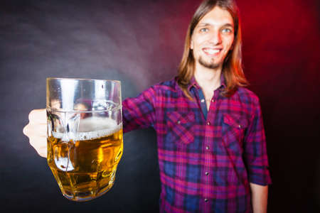 Drinking alcohol liquor relax concept. Young man drinking pint. Male in shirt holding stein with beer.