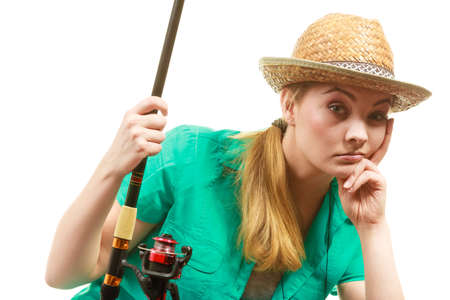 sportfishing: Fishery, spinning equipment, angling sport and activity concept. Bored woman with fishing rod, waiting for fish to hunt.