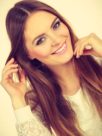 Beauty of feminince concept. Portrait of happy, positive attractive woman with long brunette hair. Stok Fotoğraf