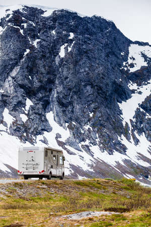 Tourism vacation and travel. Camper van and mountains landscape in Norway