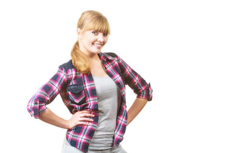 Casual female clothing concept. Happy cheerful looking woman in checkered shirt with tied blonde hair
