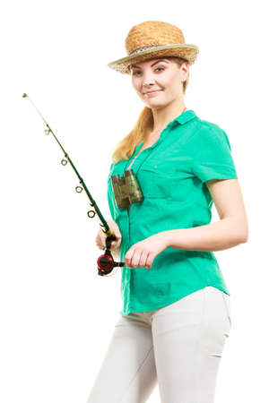 Fishery, spinning equipment, angling sport and activity concept. Happy smiling woman with fishing rod.