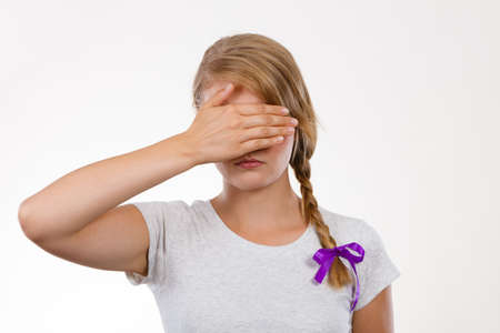 timidity: Anxiety, bullying at school concept. Shy teenage girl covering her face with hands. Stock Photo