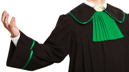 Successful life. Lawyer wear polish toga with arm in air. Educated man with career feel power. Stock Photo