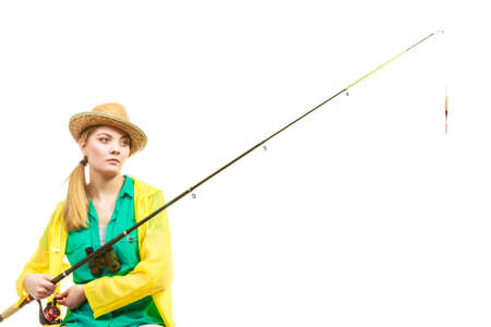 tiredness: Fishery, spinning equipment, angling sport and activity concept. Bored woman with fishing rod, waiting for fish to hunt.