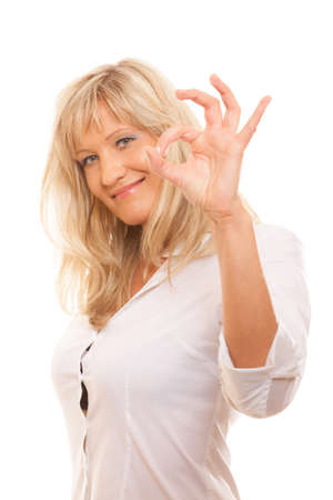 Business, gesture and office concept. Happy mature woman showing ok sign isolated