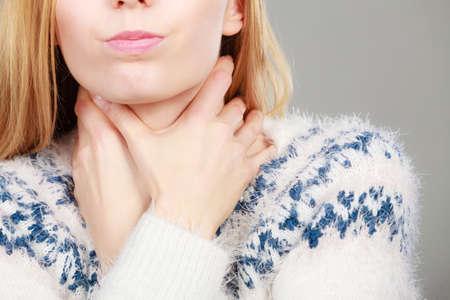 Feeling bad, disease, illness problem concept. Woman having sore throat, thouching her neck feeling pain Zdjęcie Seryjne