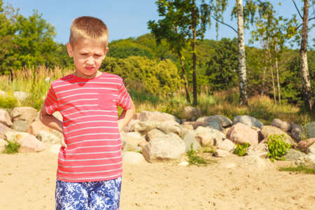 Leisure and free time concept. Portrait of little boy spending time outside on fresh air. Male kid outdoor on holidays vacation. photo
