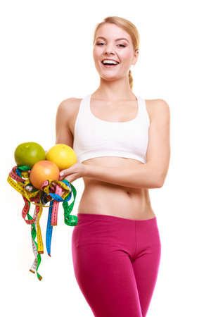 Happy joyful young woman girl holding grapefruits and tape measures. Slimming and dieting. Healthy lifestyle nutrition concept. Isolated on white. Stock Photo