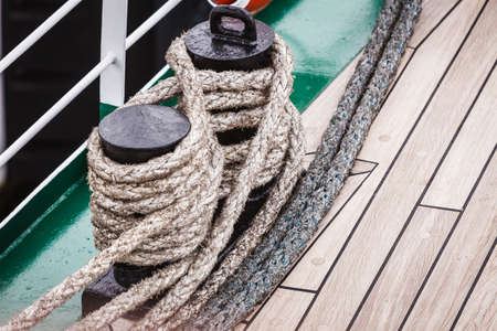 Jetty objects concept. Harbor marina bolt with ship and boats ropes, outdoor shot Stock Photo