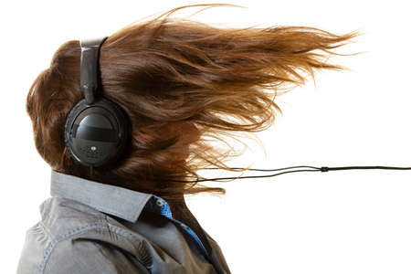Music devices, digital sound concept. Man listening to music on headphones, windblown long hair