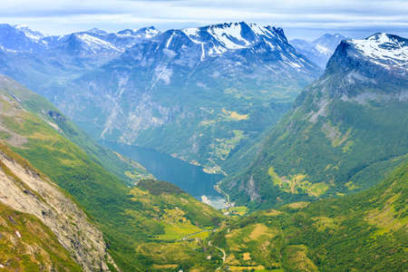 Tourism vacation and travel. Fantastic view on Geirangerfjord and mountains landscape from the Dalsnibba Plateau viewpoint, Norway Scandinavia. Stock Photo
