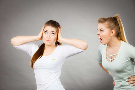 hostile: Two women having argue fight being mad at each other. Female telling off, ignorance concept.