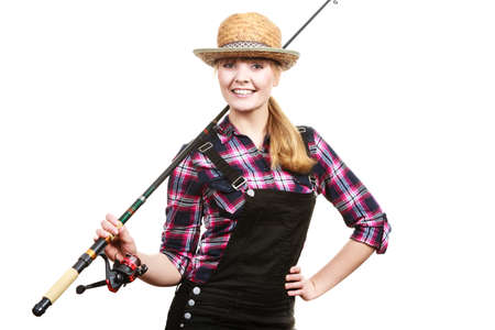 dungarees: Spinning, angling, cheerful fisherwoman concept. Happy woman in sun hat holding fishing rod, having fun and smiling.
